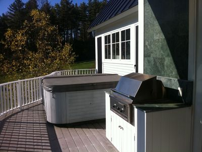 Hot tub and propane/stainless barbecue.