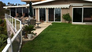 San Clemente bungalow photo - Private fenced large deck and grass backyard that looks out to the Ocean