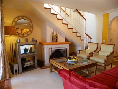 Casares Costa apartment rental - Living area with TV and open fireplace