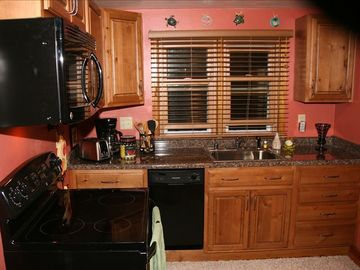 Range, over the range microwave, dishwasher, coffee maker, toaster, refrigerator