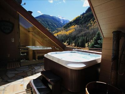 The master deck features a hot tub and glass-enclosed sauna with views.