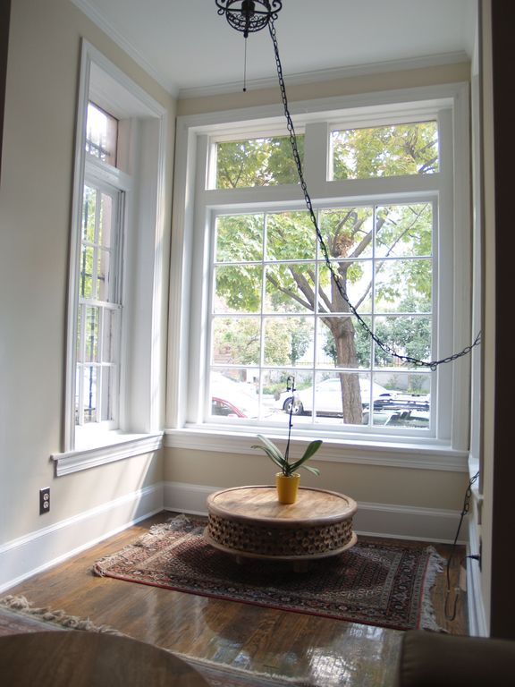 Large bay windows bring in the light and views of our tree-lined street