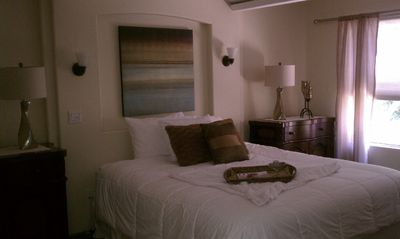 Master Bedroom with Cal King bed, TV, Spa bath