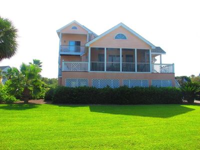 Harbor Island house rental - The outside yard's Palms,shrubs, Green Grass is BEAUTIFUL- go inside its awesome