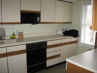Fully equipped kitchen w/dishwasher and pass through to the dining room.
