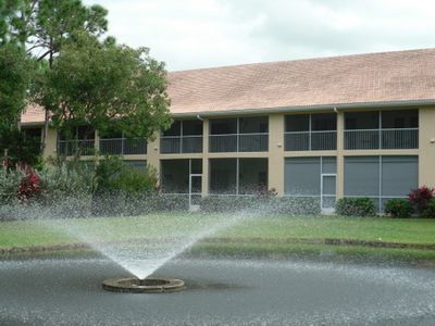 There is a lighted fountain and pond visible from the lanai, which on the left.