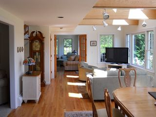 Chatham house photo - Great Room includes Dining and Sitting Areas. Family Room through French Doors