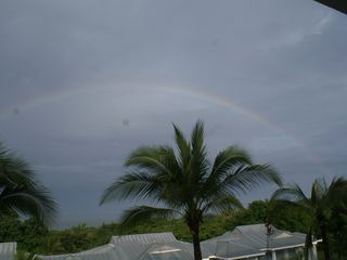 Playa Azul condo photo - Rainbow over Pacific at sunrise