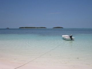 Great boat for snorkeling, fishing, and exploring the nearby reefs. - Spanish Wells villa vacation rental photo