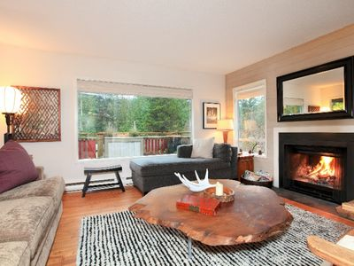 Bowen Island house rental - Main living room with wood burning fire place. Both sofas long enough to sleep.