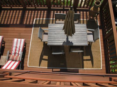 Deck with chaise lounges, umbrella, table and chairs for 6.