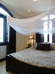 Queen size beds in each suite. - Da Nang villa vacation rental photo