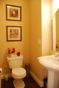 Downstairs half-bath with pedestal sink.
