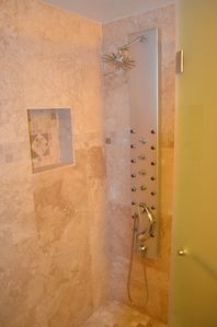 Guest bathroom shower panel w multi port massage nozzles