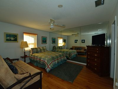 Large bed room with bed and pull out futon
