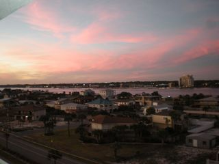 Okaloosa Island condo photo - Looking from kitchen (balcony walkway) to the Intercoastal Waterway