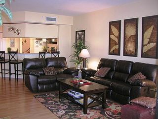 Punta Gorda condo photo - Living room with kitchen in the background. Four of these seats recline.