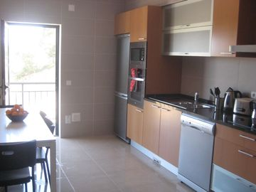 Large fully-stocked Kitchen with Balcony & BBQ