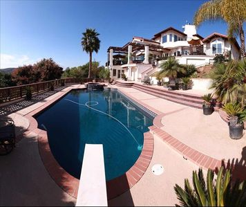 Multi-level patio with full sized pool and jacuzzi.