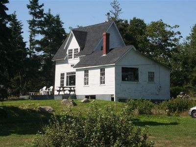 View of Cottage with Picture Windows; DR on right and LR on left