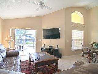 Emerald Island villa photo - 55in LED TV with cable, DVD, pool view & comfortable seating for everyone!