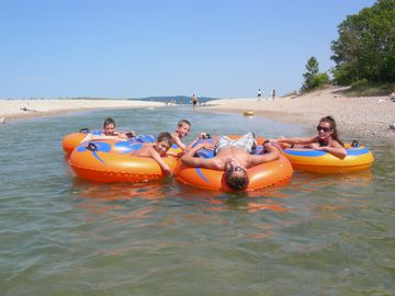 Tubing down the river to lake MI. Beaches and inland lakes are all close by.