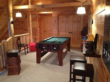 Gameroom with air hockey and pool table