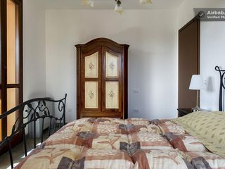 Montopoli Val d'Arno house photo - Traditional decor and sunny corner location has views of vineyard and woods.