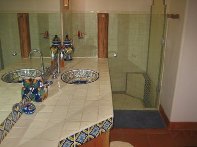Commodious Master Bath with festive talavera tile