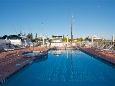 Heated pool with a with a view of the marina.