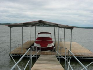 Kentucky Lake house photo - Covered boat slip and large deck for fishing or sunning (boat not included).