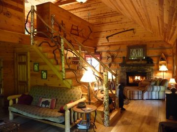 Great room with Woodburning Stone Fireplace and Cathedral Ceilings