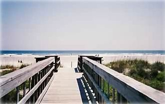 Walkway leading to the wide sandy beach