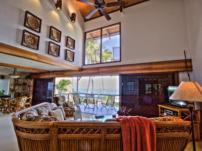 The tropical livingroom, our entertainment locale, has a 2-story vaulted ceiling