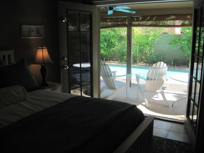 Master Bedroom through double doors leading out to pool/patio