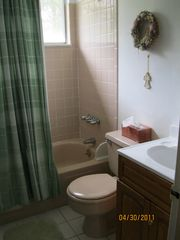 Southold house photo - 1 of 2 full bathrooms