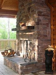 Jamestown cabin photo - Wood burning fireplace under covered porch