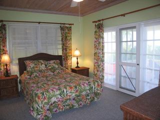 Bedroom 2 offers king bed, bathroom en suite, and wonderful ocean views. - Spanish Wells villa vacation rental photo
