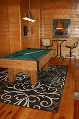 Pigeon Forge cabin photo - Pool table and dart board room with pub table and 32 inch flat-panel TV.