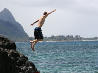 Princeville condo photo - Jumping into the ocean at Hideaways Beach