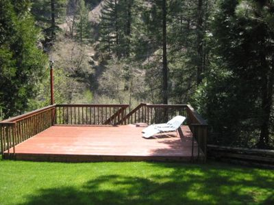 Sun deck with stairs accessing the creek.
