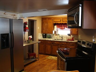 New stainless steel appliances, fully stocked kitchen, dining table for eight
