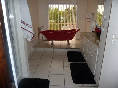 Guest bathroom. Soak in a deep tub while watching the boat traffic on the river