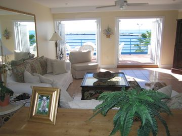 Living room and with french doors to the balcony.