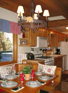 Full Kitchen and Cozy Dining Area with River View