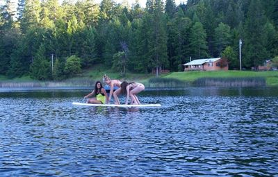 Fun on SkyCrest Lake. Cattail Cabin in background