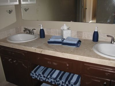 Master bath with dual sinks, stand up tiled shower