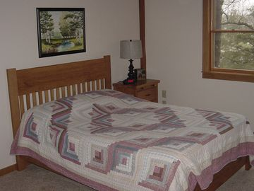 Bedroom with queen mattress also has the crib.