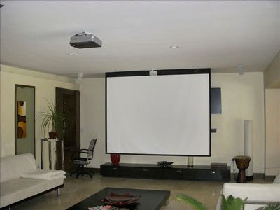 Living room with big movie screen and surround sound