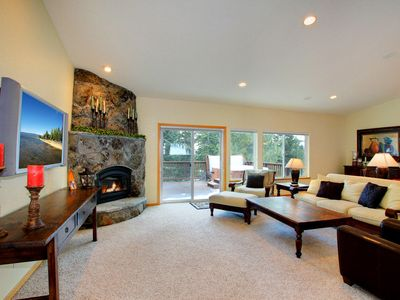 Spacious living room with flat screen T.V. and fireplace
